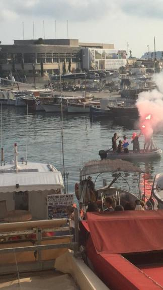 Normal maritime rules don't apply if your country wins the World Cup. Life jackets are not required, but letting off flares is fine. This is why Australia will never win. In Australia, these guys would have been arrested and publicly shamed on Today Tonight as an example of Soccer Hooliganism.