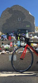 The Tom simpson Memorial. I'm not sure why people leave plastic bottles here. The winds here are crazy and most of the stuff would get blown away. The bike is mine, not a tribute left by a lazy rich person who comked out before the finish.