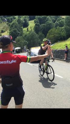 One of Le Tour riders joking with a guide. 'Did they go this way?'